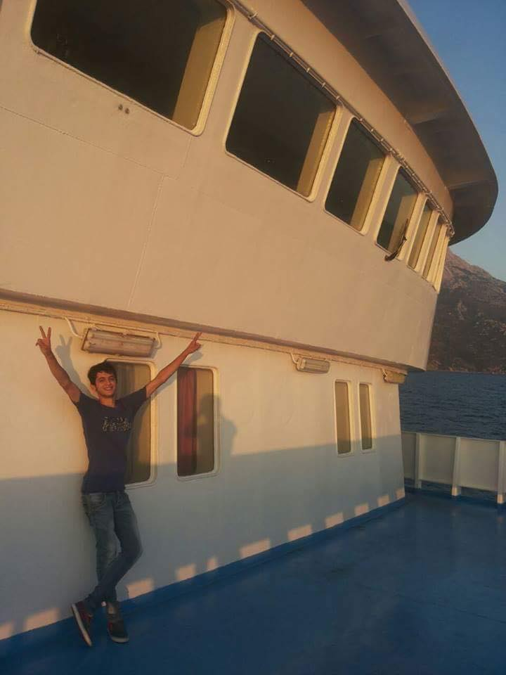Muhammad raising the victory sign while sailing to Athens from the island of Samos.