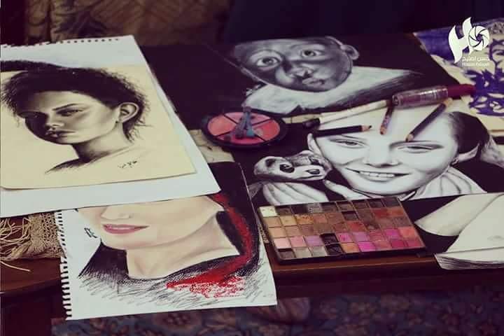 display of Kholoud's artwork