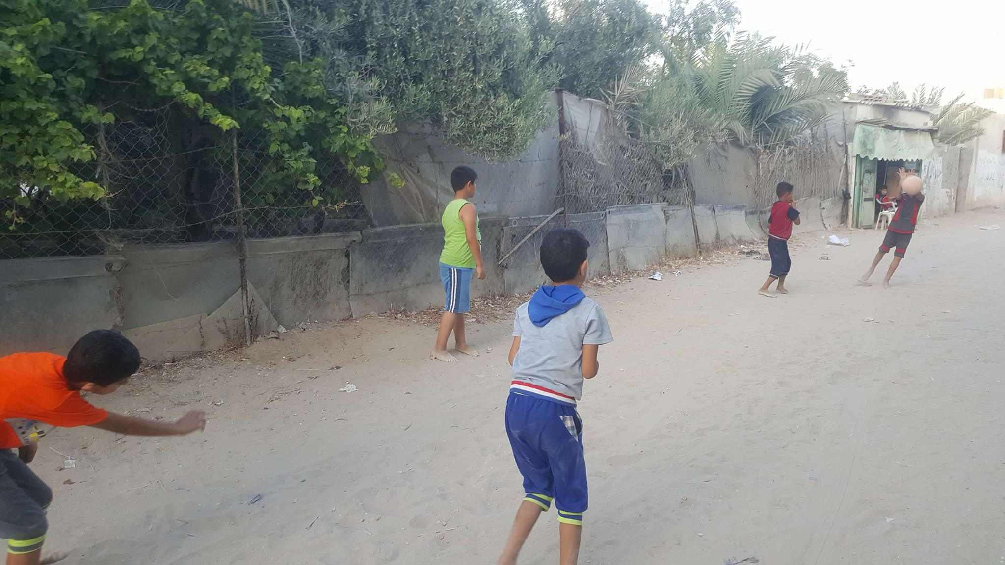 Boys playing in the street