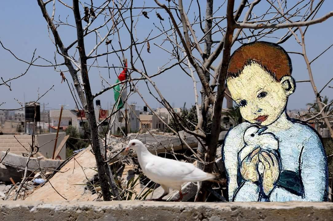 A boy shelters a bird with destruction in the background