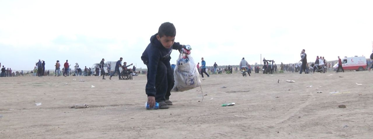 Boy collecting trash to recycle for money