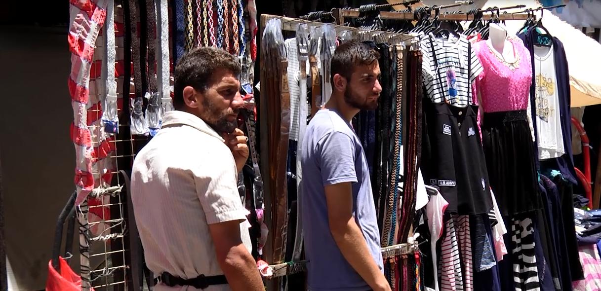 Gaza men shopping for clothing
