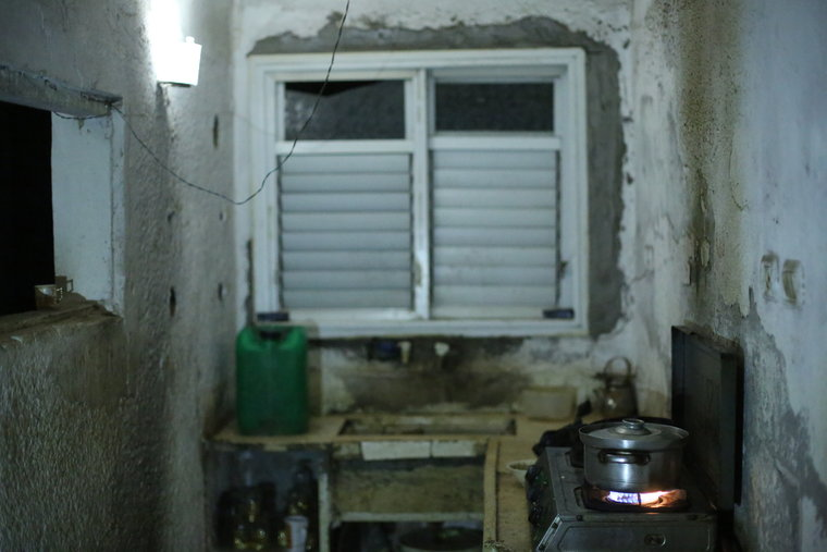 Kitchen in poverty-stricken home in Gaza
