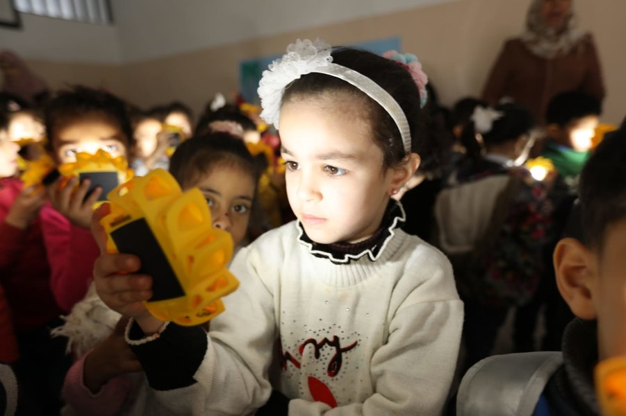 Little girl with solar lamp
