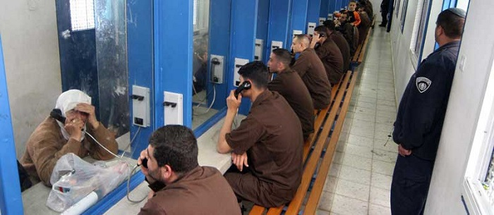 Prisoners on phone with visitors