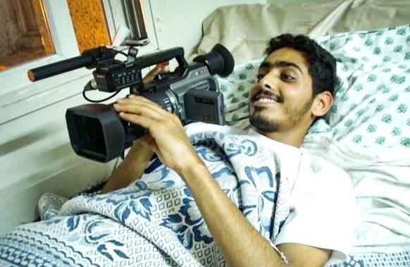 patient in hospital bed with camera