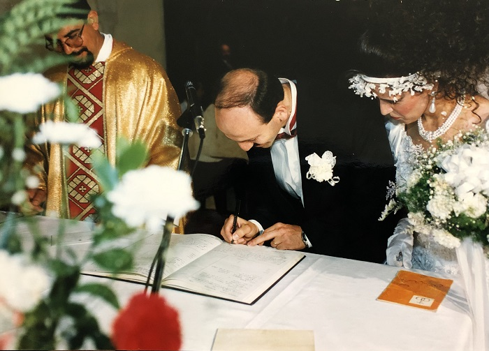 bride and groom signing book