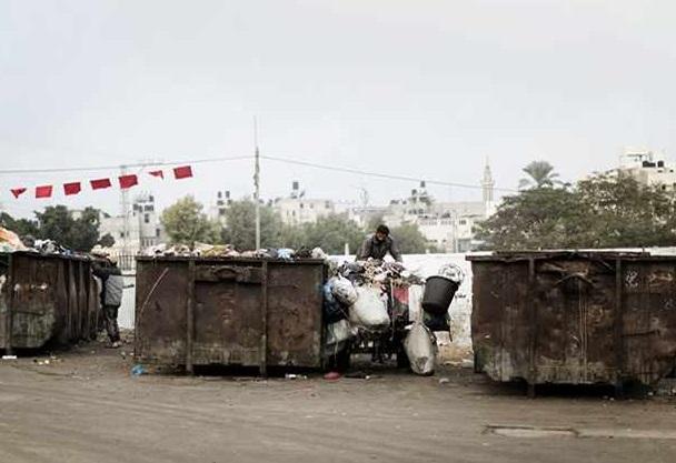 donkey cart at garbage dump